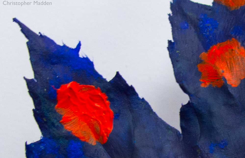 Contemporary art and the environment - a maple leaf painted blue with red polka dots