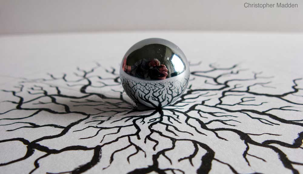reflective sphere sculpture - reflection creating eyeball effect