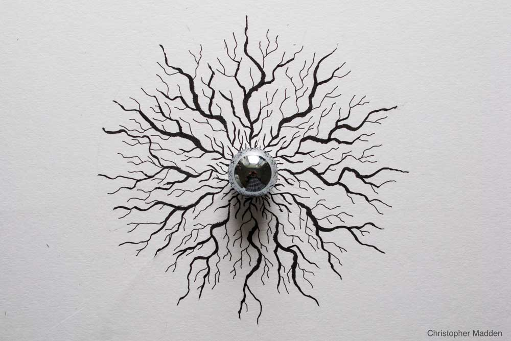 steel ball sculpture - reflections creating eyeball effect