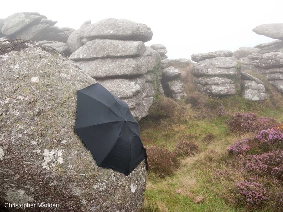contemporary land art Cornwall - umbrella attached to a rock