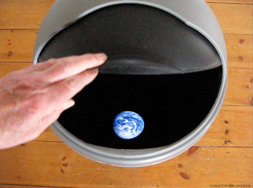 Environmental contemporary art installation - planet earth in a rubbish bin