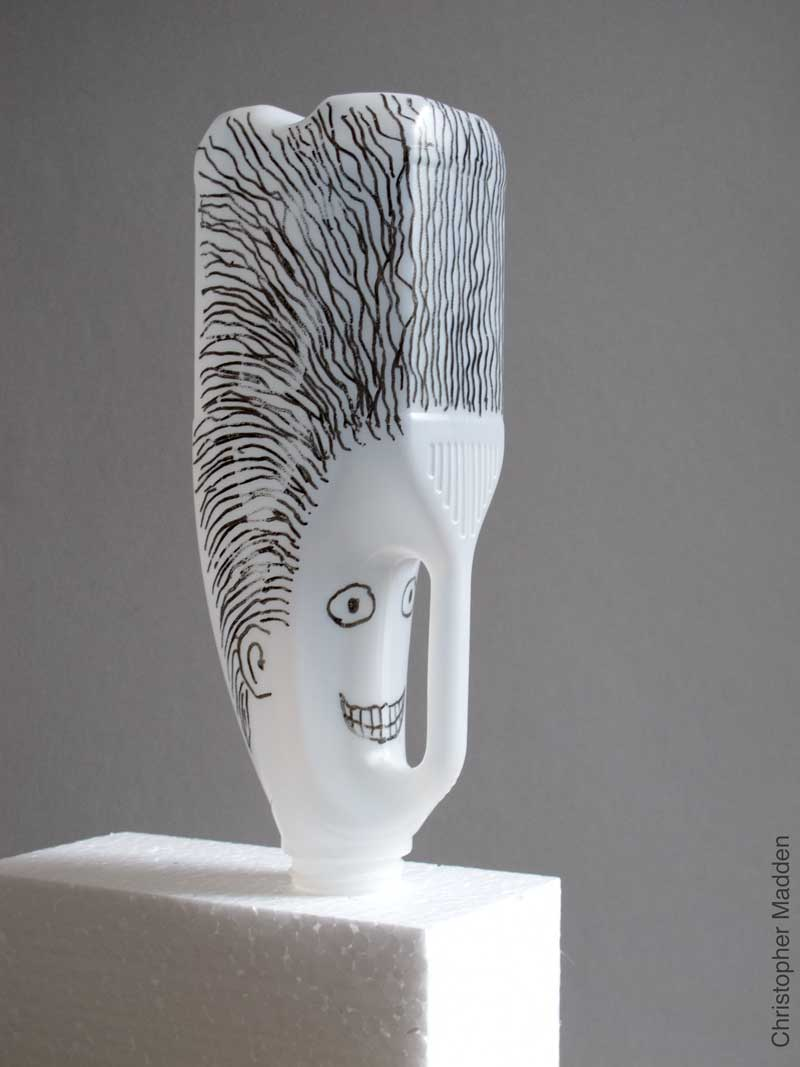 contemporary environmental sculpture from consumer waste - sculptural head created from milk bottles