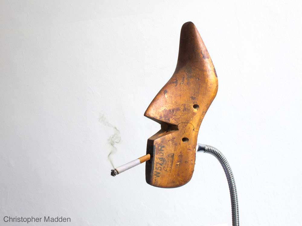 Surrealist contemporary art - shoe last smoking cigarette