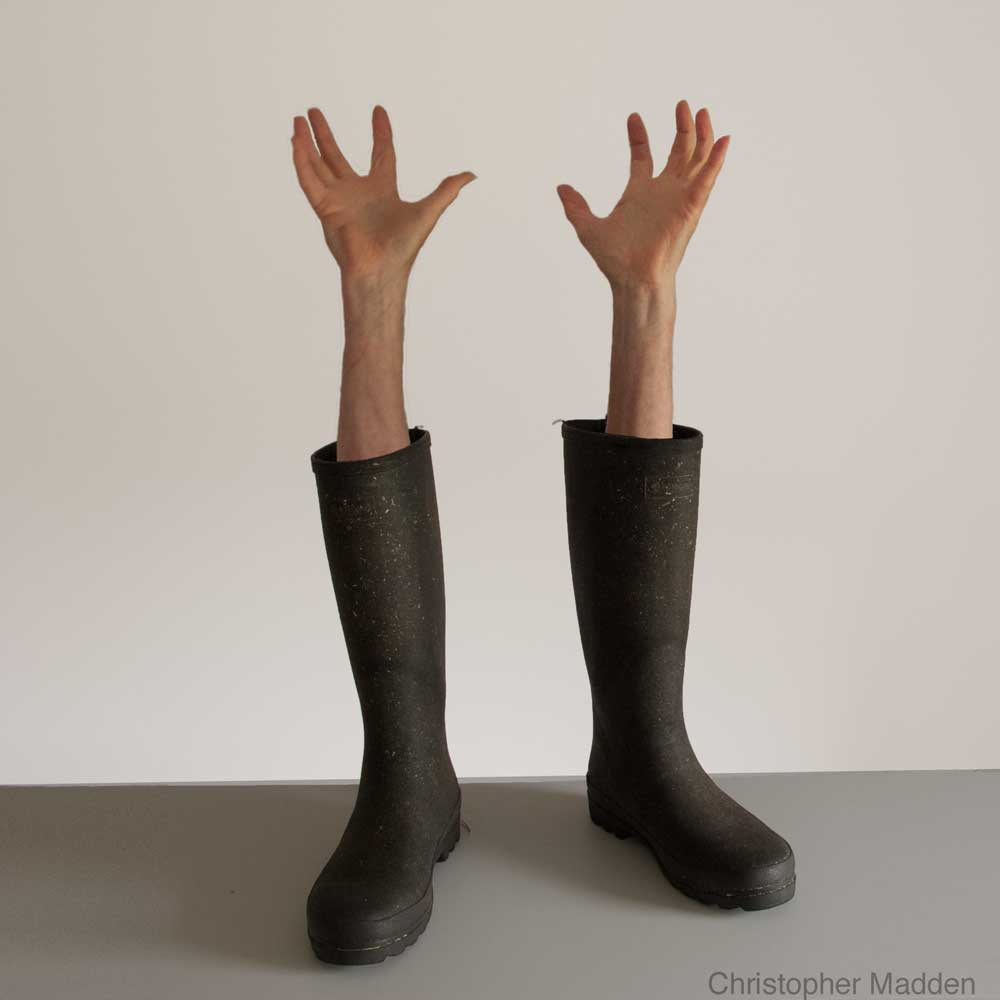 contemporary surrealist photomontage - wellington boots with arms emerging
