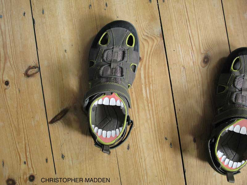 surrealist shoes with mouths and teeth