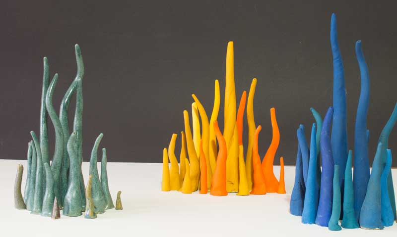 Contemporary ceramics - clusters of coloured ceramic cones or filaments
